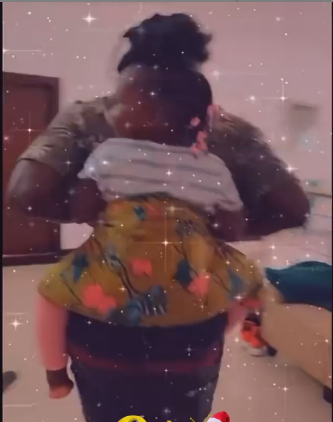 Stonebwoy Carries Daughter Jidula on His Back as Son Janam Cries Out of Jealosy [Video]